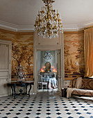 View from historical parlour with toile de jouy wallpaper into dining room