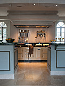 Opening between two kitchen counters leading to large AGA cooker in kitchen