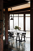 Table and chairs in front of a window in the dining area with slate tiles