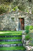 Stone house in Mediterranean landscape