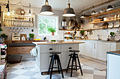 Chequered floor in rustic country-house kitchen