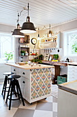 Kitchen island with wallpaper on end in Scandinavian country-house kitchen