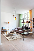 Vases on delicate partition shelving screening living room