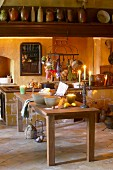 Baking utensils on table in rustic candlelit kitchen