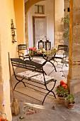 Metal furniture on Mediterranean veranda