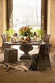 Solid stone table and wicker chairs in rustic country-house interior with historical ambiance