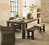 Rustic dining area in country-house kitchen with stone floor and Mediterranean ambiance