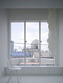 Chair next to window with view of Tokyo, Japan