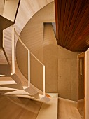 Wood-clad stairwell with designer stairs and doorway