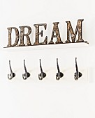 Decorative letters spelling 'DREAM' above row of hooks
