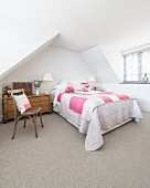 Pink accents in attic bedroom