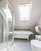 Modern free-standing bathtub in attic bedroom