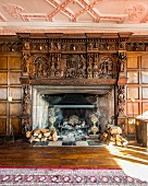 Open fireplace with enormous carved wooden surround