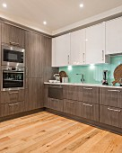 Elegant fitted kitchen with glass splashback