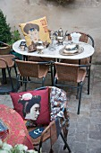 Antique silverware and Oriental cushion on marble table