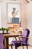 Picture of cockerel and purple upholstered dining chairs in dining room