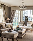 Period furniture and chandelier in elegant living room in shades of grey