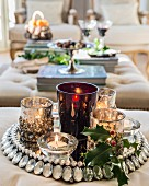 Tealight holder and sprig of holly on rhinestone tray