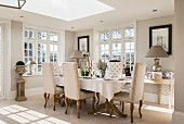 Period furniture and skylights in elegant living room in shades of cream