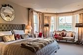 Baroque sofa in window bay in elegant bedroom