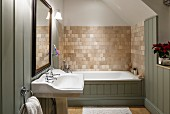 Country-house bathroom with wall tiles and wood cladding