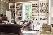 Pair of leather sofas in library with open shelving