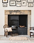 Original fireplace and antique chair on stone-flagged floor