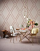 Dining table and chairs with gold legs against rhombus wall