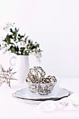 Filigree Christmas balls with rhinestones in a glass bowl