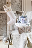 Stack of presents wrapped in white and silver