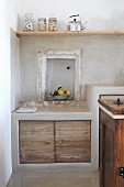 Niche above kitchen base unit in traditional, Mediterranean-style kitchen