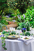 Lavishly set table in summer garden