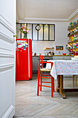 Colourful furniture and dining table in kitchen of period building