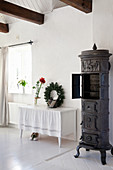 Old cast-iron stove in white country house