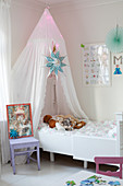 Illuminated canopy above extendable child's bed