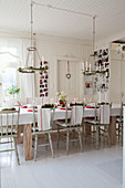 Old wooden chairs around festively decorated dining table
