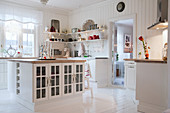 Island counter in white country-house kitchen