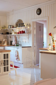 Christmas decorations in country-house kitchen decorated entirely in white