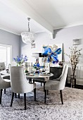 Glamorous dining room in shades of gray with blue accents