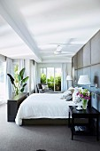 Elegant bedroom with gray upholstered wall