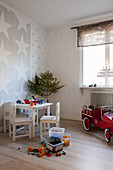 Children's table and chairs and small Christmas tree in child's bedroom