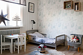 Simple child's bedroom in shades of grey