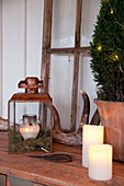 Rustic Christmas arrangement of candles, lantern and antlers