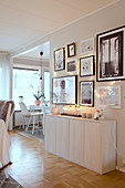 Gallery of pictures above sideboard in open-plan Scandinavian-style interior