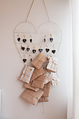 Wrapped gifts hung from wire heart as Advent calendar