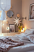 Cosy lighting in bedroom in shades of white and grey