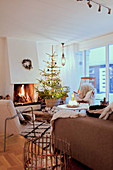 Open fireplace and Christmas tree in cosy living room
