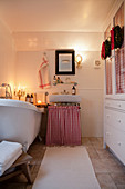 Festively decorated bathroom with cosy lighting