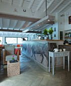 Bulls painted on front of kitchen counter below rustic wood-beamed ceiling