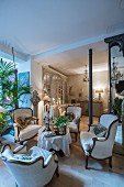 Seating groups in renovated period apartment with Belle Époque ambiance
